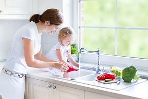 Child at sink, lowering hot water temperature