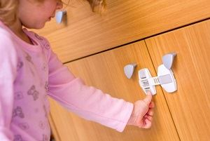 Child safety latches for cabinets